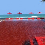 the-library-in-thailand-has-a-pool-boasting-a-unique-look-with-blood-red-tiles-creating-a-cool-effect-that-nicely-contrasts-the-beach